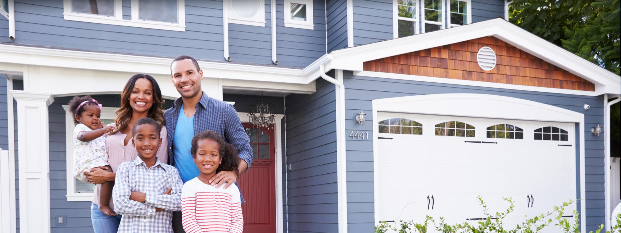 Beautiful family outside remodeled home