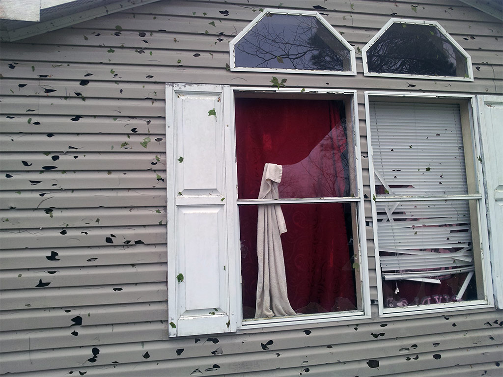 Windows and siding ruined by hail